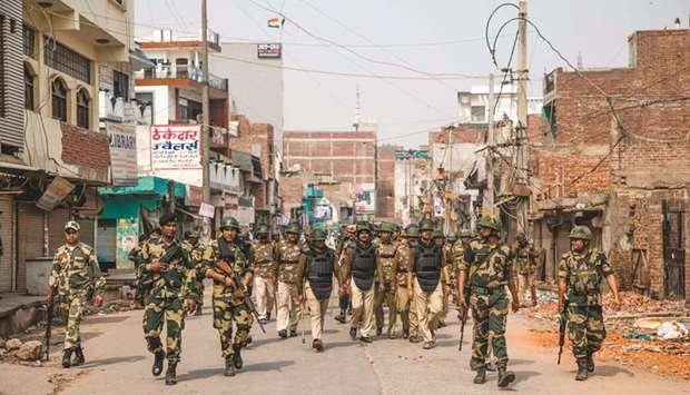 Security personnel patrol a street following sectarian riots at Shiv Vihar in New Delhi yesterday.