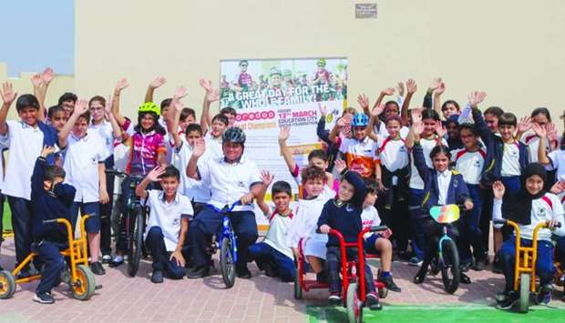 Students from Newton International School Lagoon come together to show their excitement for the Oore