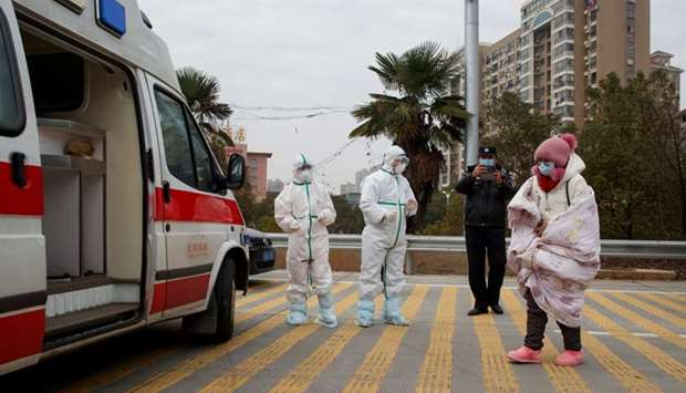 Hospital staff in protective garments pick up a leukaemia patient who arrived from the Hubei provinc