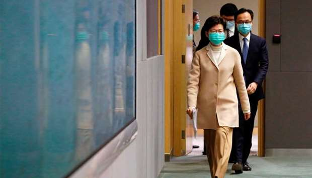 Hong Kong Chief Executive Carrie Lam wears a mask, following the outbreak of a new coronavirus, duri