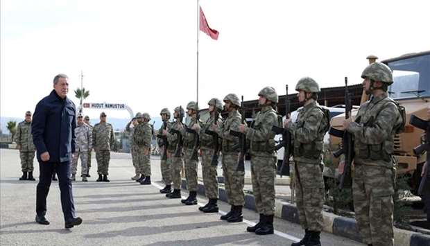 Turkish Defence Minister Hulusi Akar (L) arriving at the command coordination center near Syrian bor