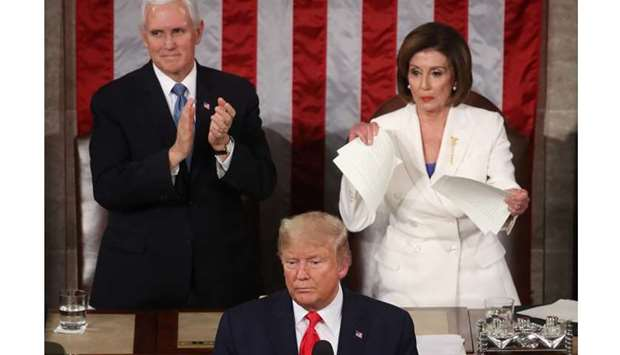 House Speaker Rep. Nancy Pelosi (D-CA) rips up pages of the State of the Union speech after US Presi