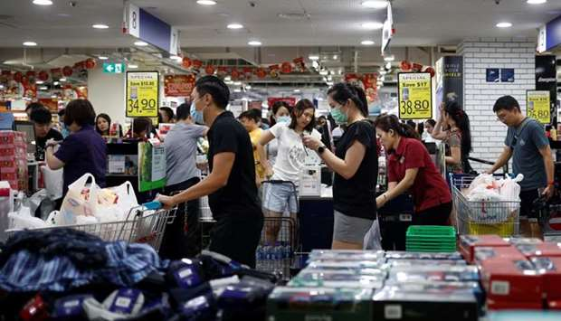 People stock up on food supplies after Singapore raised coronavirus outbreak alert to orange, at a s