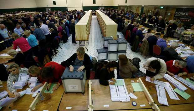 Staff members count votes in Ireland's national election, in Cork, Ireland