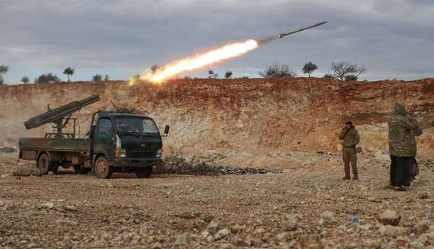 Syrian fighters fire a Grad rocket