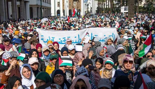Moroccans march during a demonstration against the US Middle East peace plan in the capital Rabat