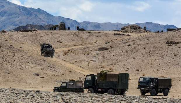 (file photo) Indian army soldiers drive vehicles along mountainous roads as they take part in a mili