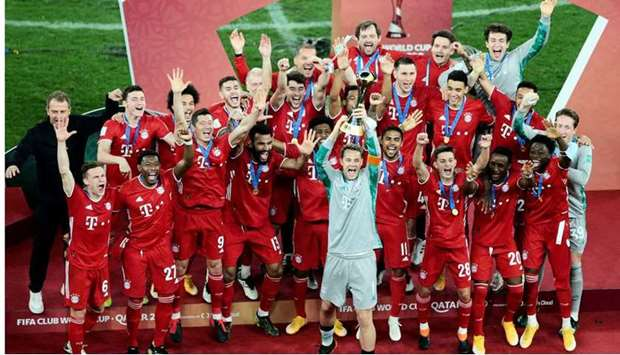 Bayern Munich players celebrating with the FIFA Club World Cup trophy at Education City Stadium yest