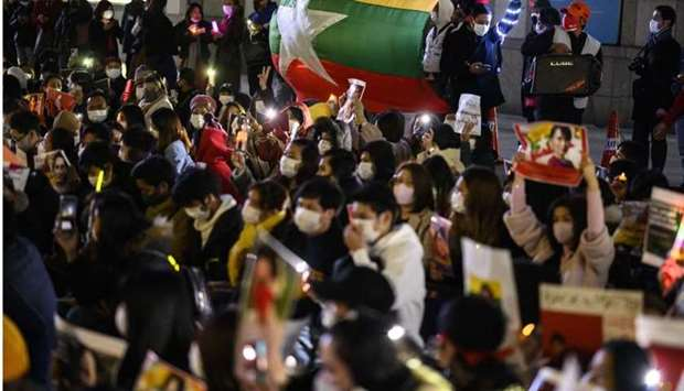 Activists take part in a protest against the military coup in Myanmar outside United Nations Univers