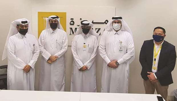 (From right) Cwallet CEO and founder Michael Javier, Meeza CTO Faisal al-Kuwari, Cwallet COO Abdulmo