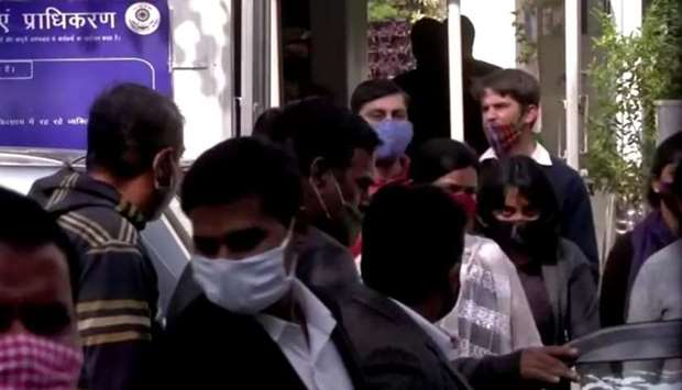 Climate change activist Disha Ravi is escorted by police officials as she walks out of the court in