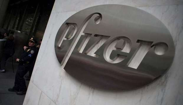 The Pfizer company logo on the wall in front of Pfizer's headquarters in New York. AFP