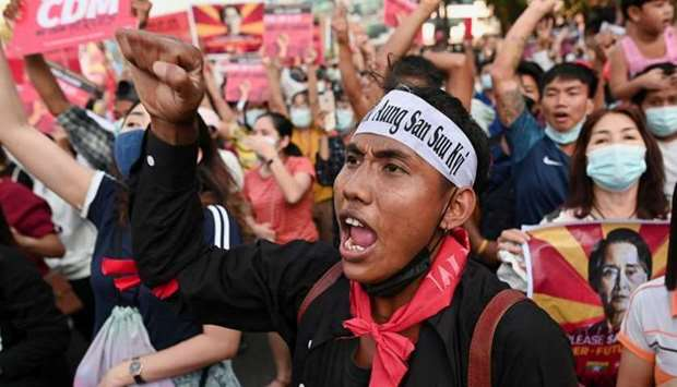 People participate in a protest against the military coup in Yangon, Myanmar