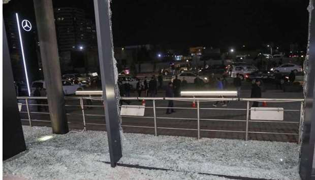 Shattered glass is pictured on the floor of a shop following a rocket attack in Arbil.