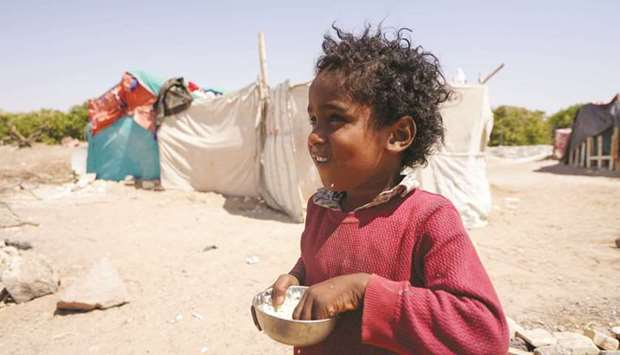 A girl is pictured at a camp for internally displaced people in Marib, Yemen yesterday.