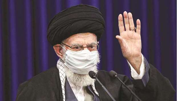 A handout picture provided by the office of Iran's Supreme Leader Ayatollah Ali Khamenei yesterday s