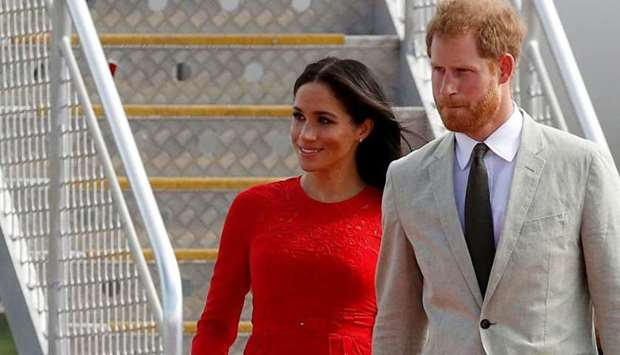 Britain's Prince Harry and Meghan, Duchess of Sussex, arrive at Fua'amotu airport on the main island
