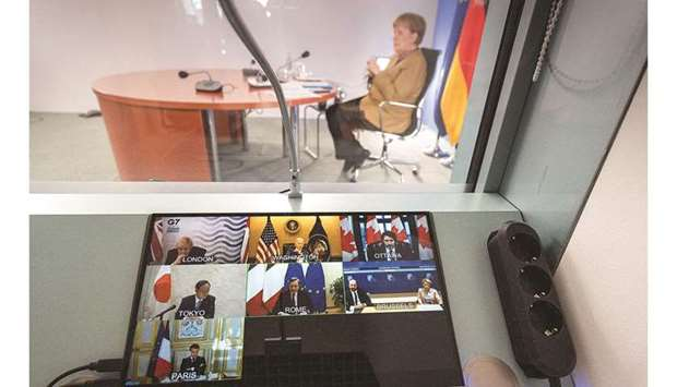 German Chancellor Merkel is seen during a virtual summit with G7 leaders, on the coronavirus (Covid-