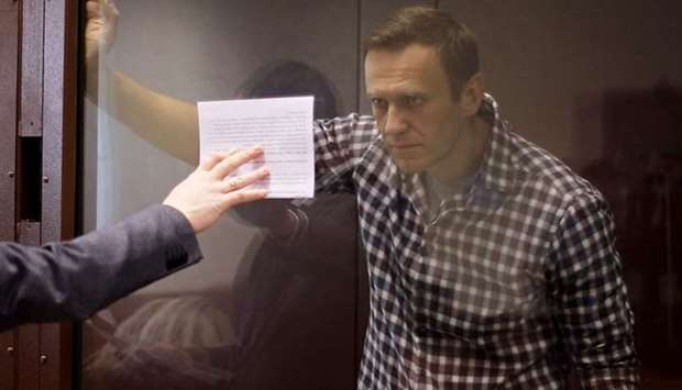 Russian opposition leader Alexei Navalny attends a hearing to consider an appeal against an earlier