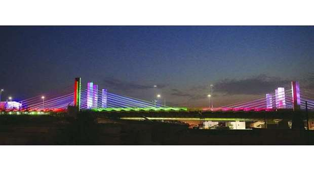 The cable-stayed bridge on Sabah Al Ahmad Corridor all decked up in colourful lights and the nationa