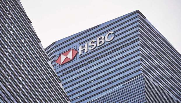 Signage for HSBC Holdings is displayed on the building that houses its headquarters in the central b
