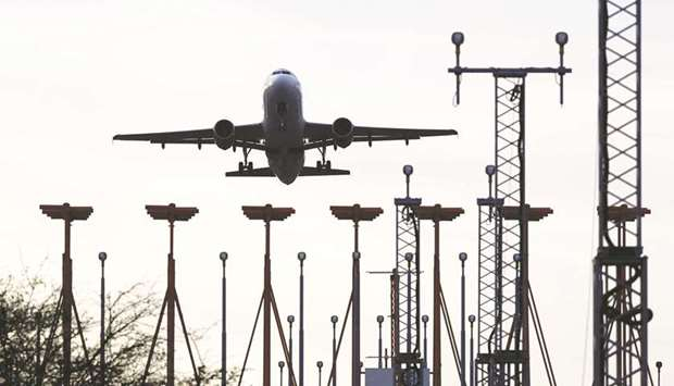 An aircraft approaches the runway at Luton airport near Luton, UK. IATA says its member airlines and