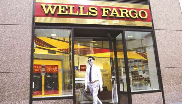 A pedestrian walks out of a Wells Fargo & Co bank branch in New York. GTCR LLC and Reverence Capital