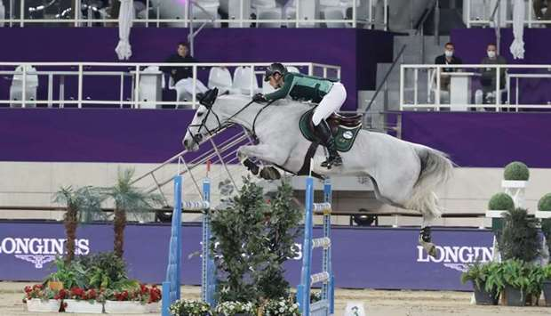 Belgium's Olivier Philippaerts astride H&M Legend of Love clears a hurdle during the Commercial Bank