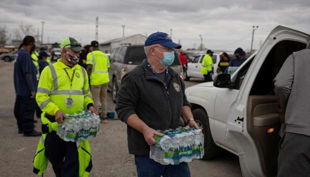 Volunteers give water to residents affected by unprecedented winter storm in Houston, Texas