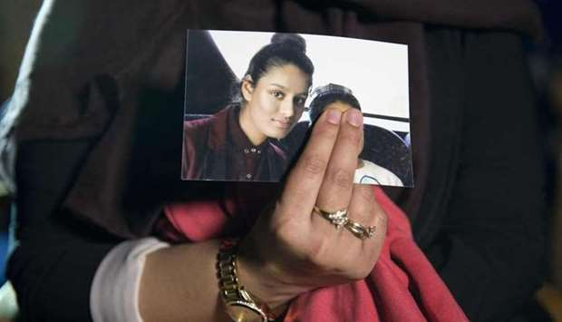 In this file photo taken on February 22, 2015 Renu, eldest sister of British girl Shamima Begum, hol