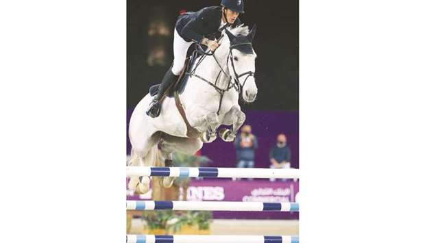France's Kevin Staut astride Tolede de Mascam Harcour clears a hurdle during Friday's feature class