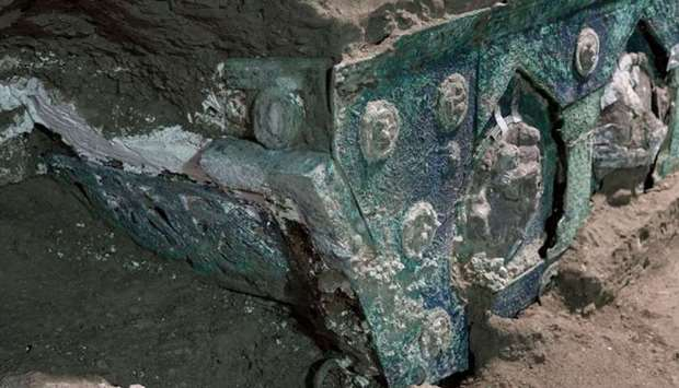 A photo handout by the archaeological park of Pompeii shows a large Roman four-wheeled ceremonial ch