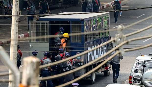 Police arrest people as they crack down on demonstrations by protesters against the military coup in
