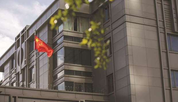 The Chinese flag stands on display outside the China Consulate General building in Houston, Texas (f