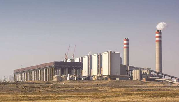 Emissions rise from the Eskom Holdings Kusile coal-fired power station near Witbank in Mpumalanga, S