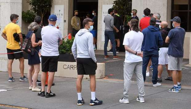 Tennis players queue for a Covid-19 coronavirus test at a hotel in Melbourne
