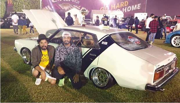 Ismail Waheed (left), and Abdullah al-Hajri with their prize-winning car.