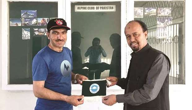 This undated picture shows Mohamed Ali Sadpara (left) with a member of Alpine Club of Pakistan in Is