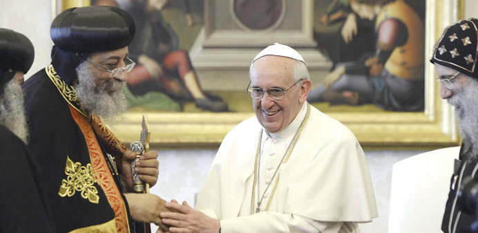Pope Francis greets Tawadros II at the Vatican yesterday.