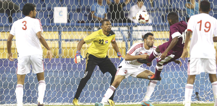 Khalfan Ibrahim scores with a header for Qatar in their Asian Cup qualifier against Yemen yesterday.