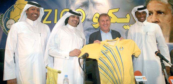 Al Gharafa officials pose with Zico after the Brazilian signed a two-year deal to coach the club yes