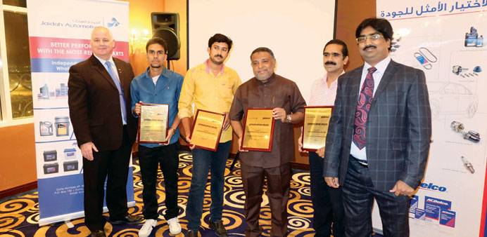 Officials with those honoured at the event.