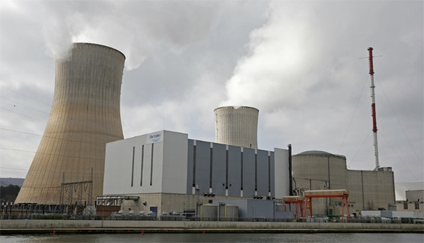 Steam escapes from the cooling tower of the Tihange nuclear power station, Belgium