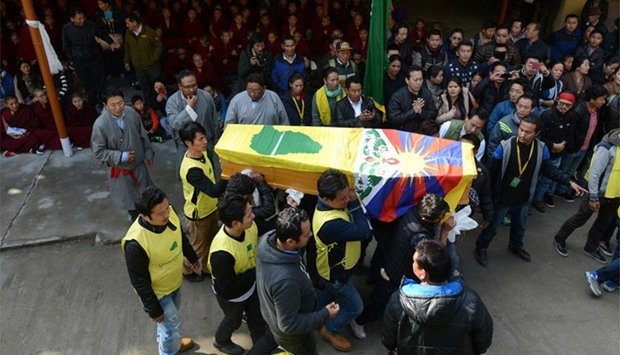 Members of the Tibetan Youth Congress carry the coffin bearing the body of Dorje Tsering