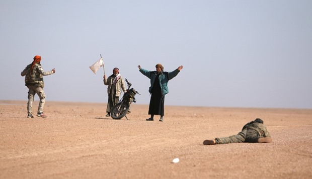 Men that fled areas of clashes surrender to Syrian Democratic Forces (SDF) fighters north of Raqqa c