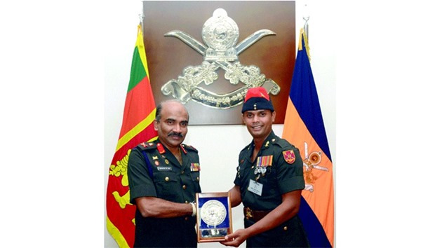 Sri Lanka promotes two cricketing soldiers
