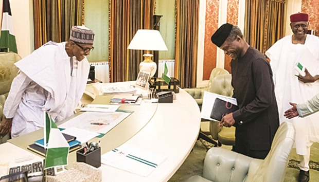 buhari officially back to work presidency