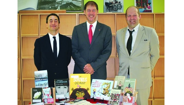 French Ambassador Eric Chevallier (left) receiving the books from Canadian Ambassador Adrian Norfolk