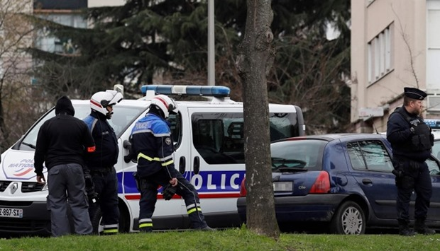 Police officers investigate at the house of the suspect of an attack at the Paris Orly airport