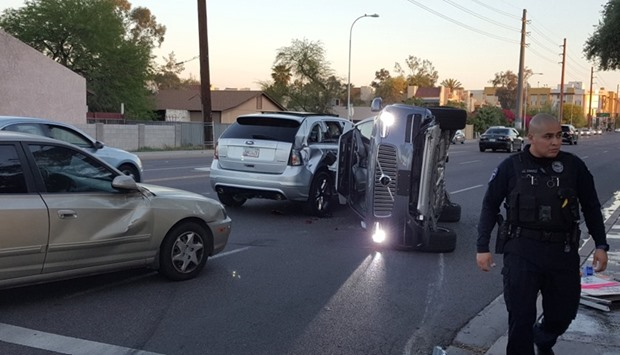 A self-driven Volvo SUV owned and operated by Uber Technologies Inc. is flipped on its side after a